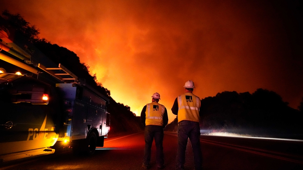 California fires rage as winds continue and power is shut off