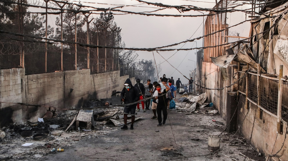 In Pictures: Huge fire reduces Moria refugee camp to embers