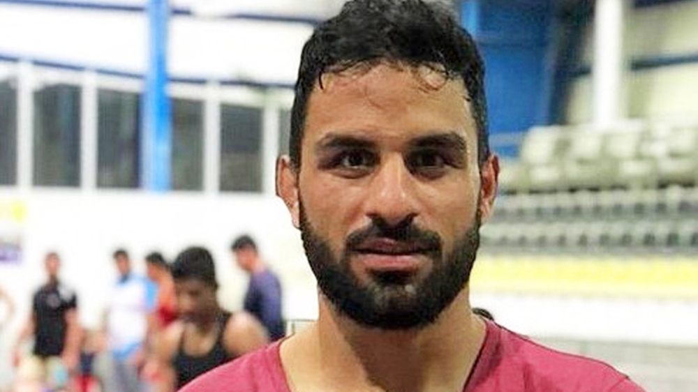 Iran: Gov't distances itself from execution of wrestler Afkari