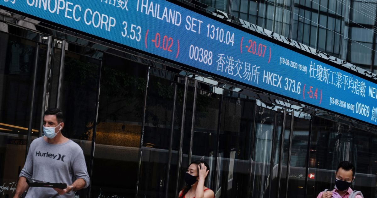 Stocks hold near record highs but vaccine concerns cloud outlook