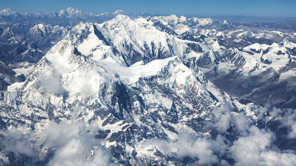 Why did Mount Everest's height change?